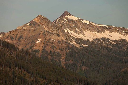 Sawtooth Peak (right) capped by Columbia River Basalt.  Beneath it is granite of the Wallow Batholith --and off to the left, are the bedded rocks of the Martin Bridge Limestone.