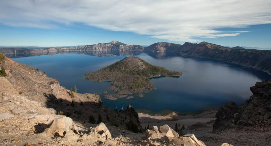 Crater Lake as seen from The Watchman.  Wizard Island, which formed after the caldera collapse, occupies the center of the photo.