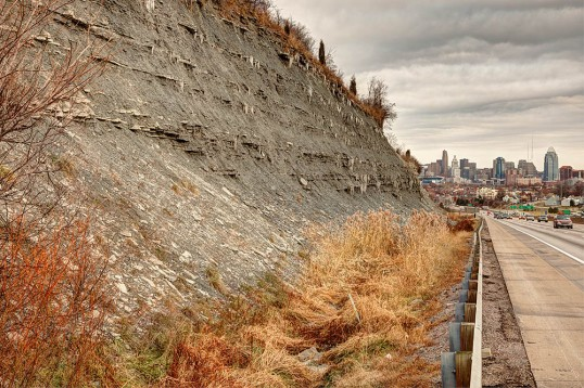 Ordovician shale and limestone along I-75 in northern Kentucky; downtown Cincinnati, Ohio occupies the background