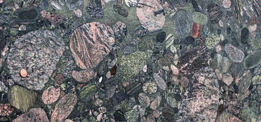 Polished conglomerate --individual cobbles are metamorphic rocks. The green color comes from the mineral chlorite.