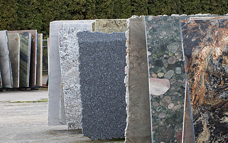 """slabs of polished rock at a """"granite"""" warehouse --not sure if any of this is actually granite, but it all reflects geologic time."""